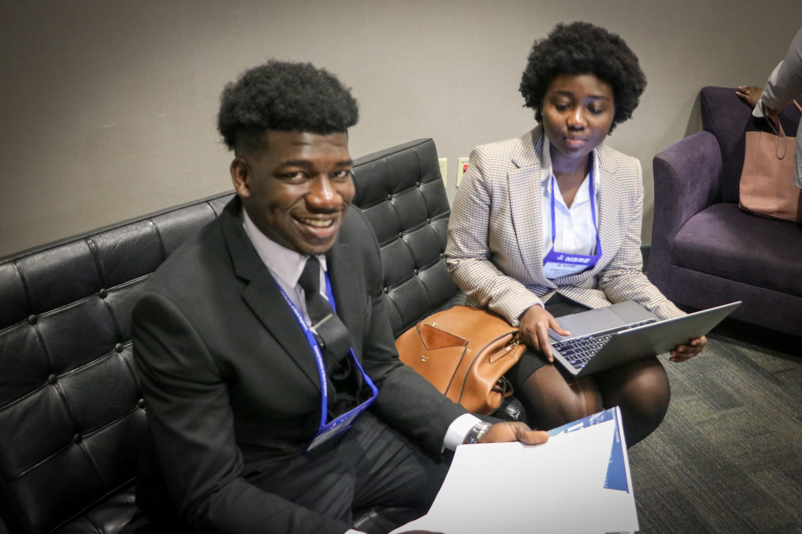 Lasana Drame works with his high school and college mentee Emmanuella Boateng at the 2019 National Society of Black Engineers' regional fall conference on her resume.