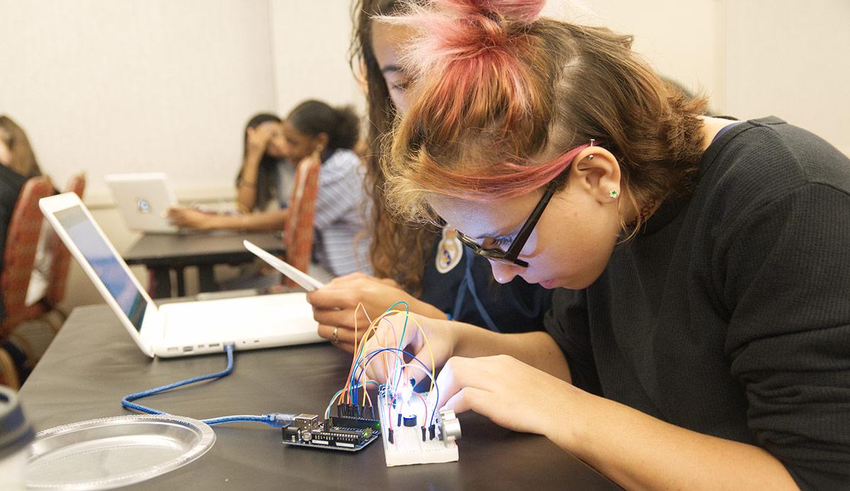 Students making electronic hardware