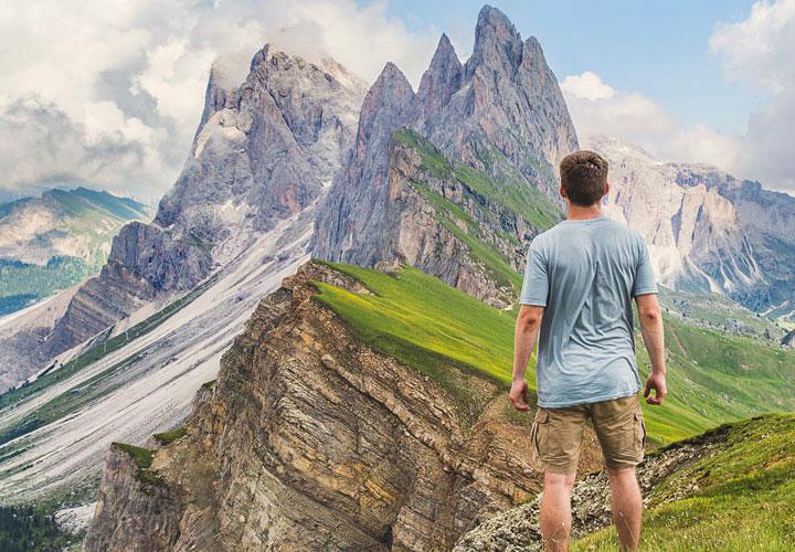 Perseverance . man climbing a mountain